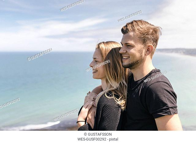 Young couple looking at view