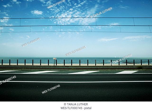 Belgium, Ostend, empty street in front of the sea