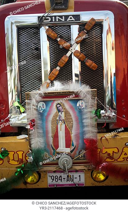 An image of the Virgin of Guadalupe and a cross decorate a truck at the pilgrimage to Our Lady of Guadalupe Basilica in Mexico City, Mexico, December 11, 2013