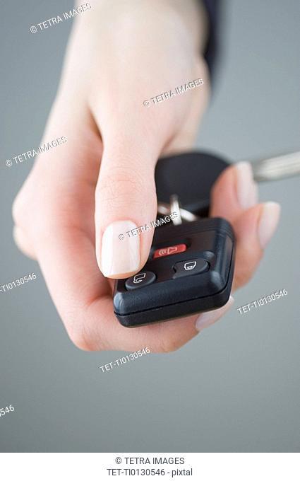 Woman pressing unlock button on keychain