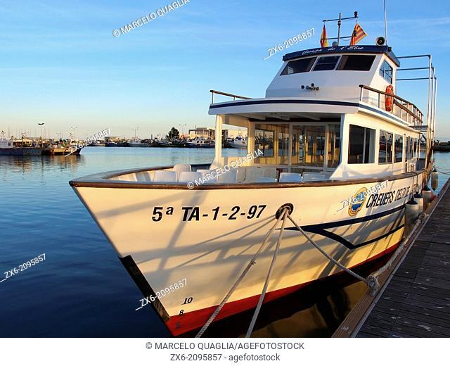Cruise ship at Sant Carles de la Rapita port. Ebro Delta Natural Park. Montsia Region, Tarragona Province, Catalonia, Spain