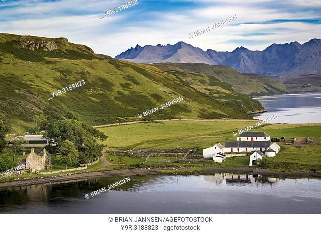 Evening over sheep farm, Gesto Bay, and the Black Cuillins beyond, Trotternish Peninsula, Isle of Skye, Scotland, UK