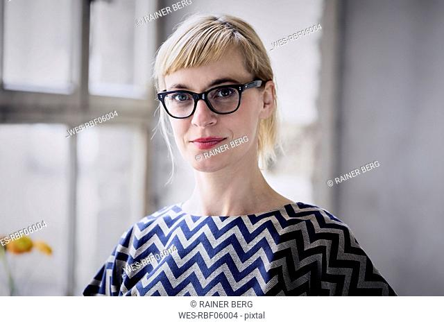 Portrait of blond businesswoman wearing glasses