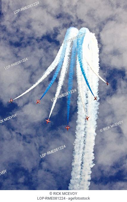 England, Dorset, Swanage. Air display by the Red Arrows at Swanage Carnival