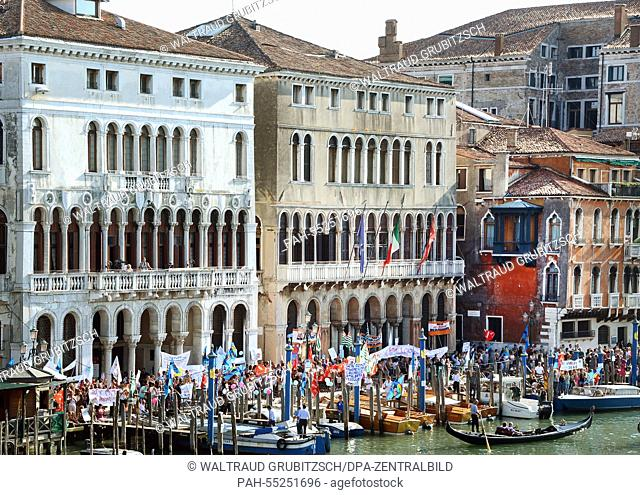 Gondolas and small boats travel on the Canal Grande passing the town hall between Palazzo Loredan (L) and Farsetti (R) inVenice, Italy, 09 September 2014