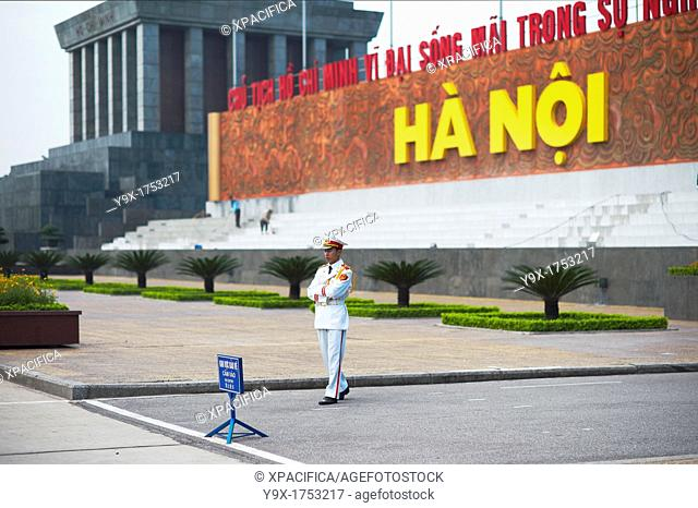A guard standing by the sign 'Hanoi' in the Ho Chi Minh Mausoleum