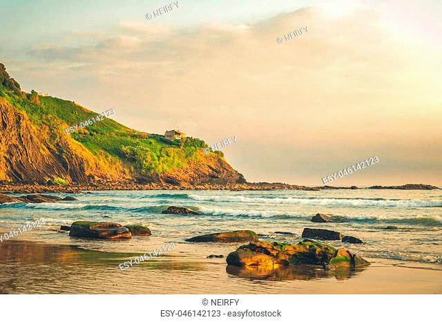 Cantabrian Sea coast, beach of Deba at sunset, Pais Vasco Spain, toned
