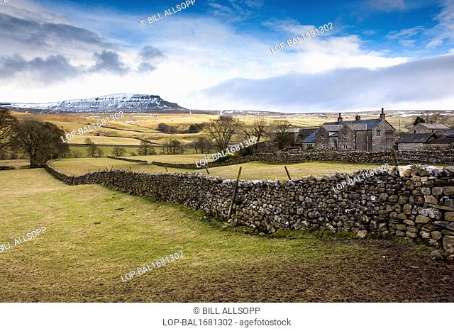 England, North Yorkshire, Horton in Ribblesdale. Pen-Y-Ghent viewed across farmland