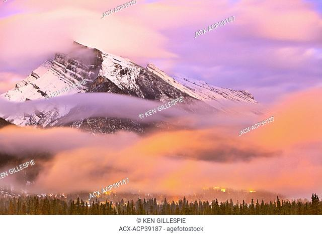 Mount Rundle, Banff townsite at dusk and dramatic clouds. Banff National Park, Alberta, Canada