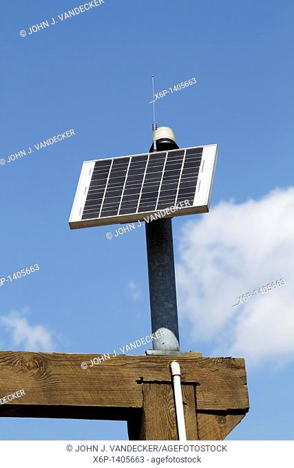 A solar panel that provides electricity to an emergency call phone at Richard DeKorte Park, Meadowlands, Lyndhurst, New Jersey, USA