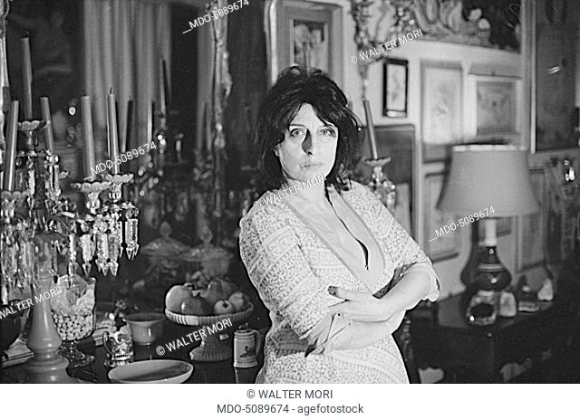 The actress and icon of Italian cinema Anna Magnani posing leaned against a cupboard for a photo shooting made in her house. Rome, May 1968