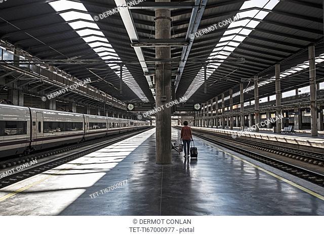 Spain, Andalusia, Cordoba, Woman on empty train platform