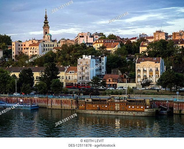Skyline and buildings along the Sava River with a view of the tower of St. Michael's Cathedral; Belgrade, Serbia