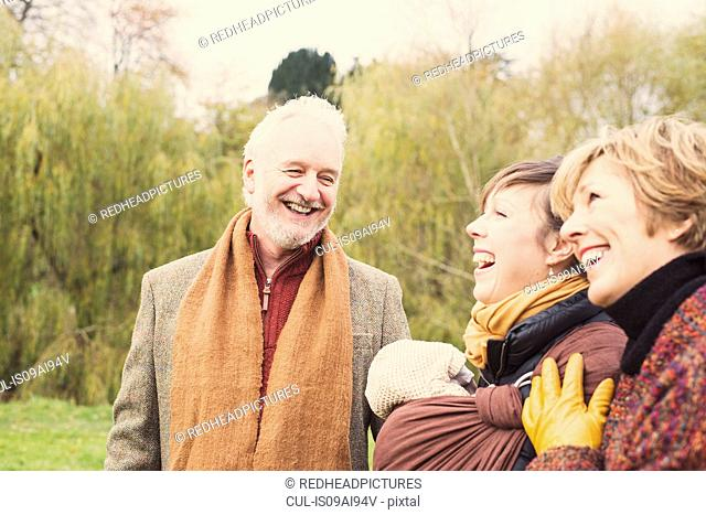 Three generation family laughing
