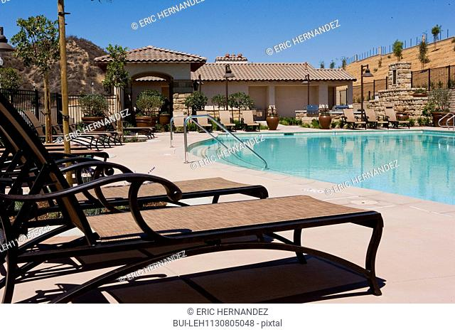 Deck chairs by the poolside; Valencia; California; USA