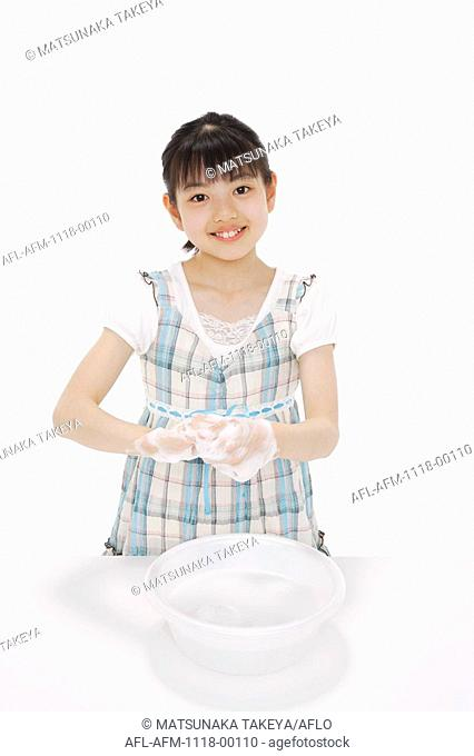 Girl with soapsuds on her hands