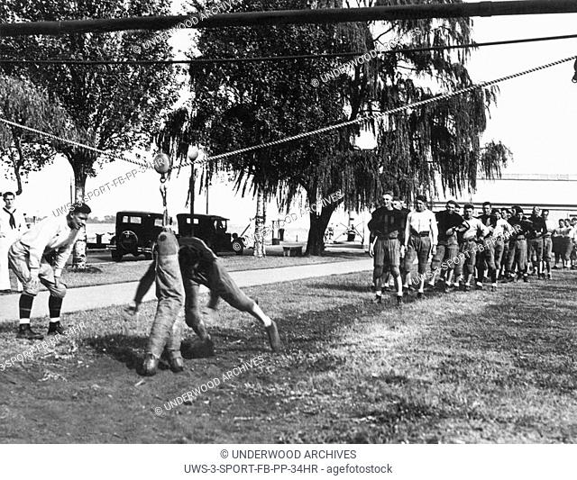 Annapolis, Maryland: August 21, 1930. Naval Academy freshmen football practice started to day. Here are some of the275 recruits working out on the tackling...