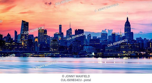 Skyline illuminated at sunset, Hoboken, New Jersey, USA