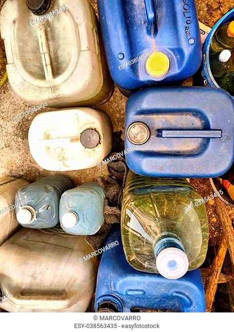 plastic containers, oil can, vertical shot