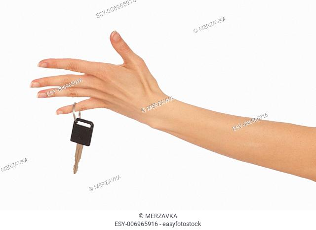 Key from a new house in the hand of woman