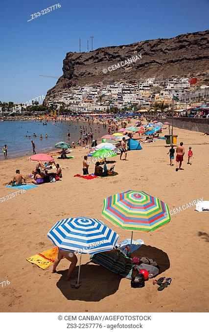 Colorful sunbeds and parasols on the beach of Puerto de Mogan, Gran Canaria, Canary Islands, Spain, Europe