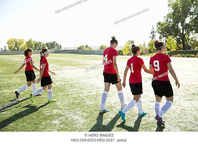 Soccer team walking off soccer field