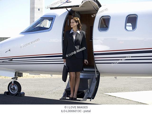 A business woman boarding a plane