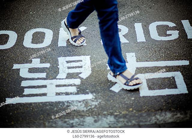 Girl walking in street. Hong Kong