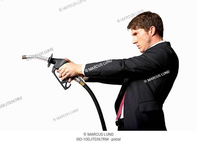 Man holding petrol pump like gun