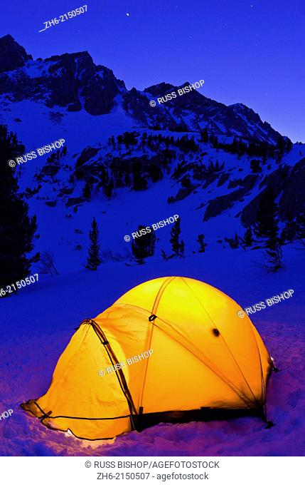 Yellow dome tent at night in winter, Inyo National Forest, Sierra Nevada Mountains, California