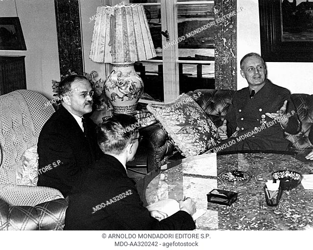 Talk between Molotov and Ribbentrop in Berlin. The Soviet Foreign Minister Vyacheslav Molotov in conversation with the German Foreign Minister Joachim von...