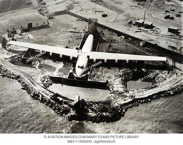 The Huge Engineless Hughes H-4 Hercules / Spruce Goose Under-Construction at Terminal-Island, San Pedro, Long Beach Harbour, California, Usa