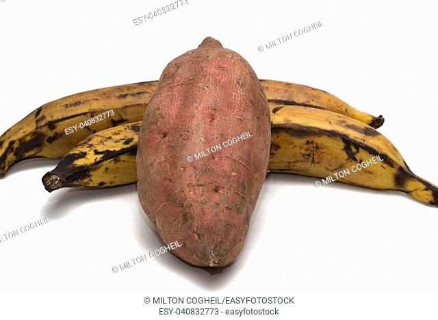 Two plantains and a sweet potato on a white background