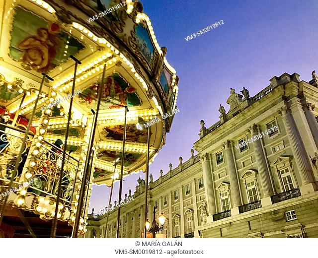 Christmas Carousel and Royal Palace, night view. Bailen street, Madrid, Spain