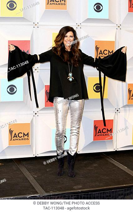 Singer Karen Fairchild of Little Big Town, winners of Vocal Group of the Year and Vocal Event of the Year awards, pose in the press room during the 51st Academy...