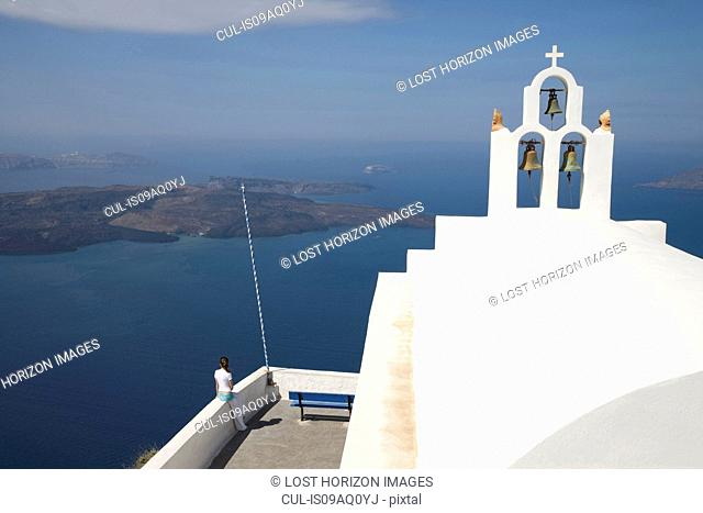 View of white washed church bell tower and sea, Oia, Santorini, Cyclades, Greece