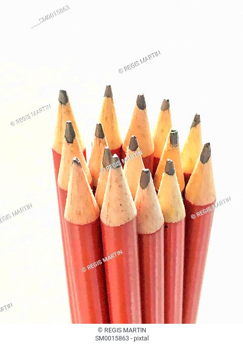 Bunch of red lead pencils against a white background