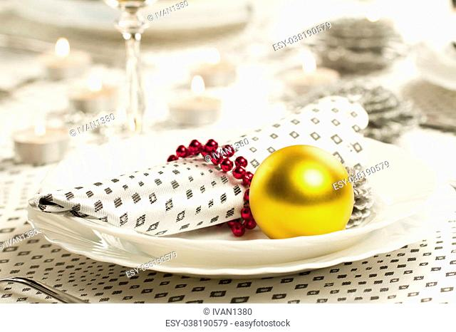 Christmas dinner table. Traditional Christmas decorations. Served table in a restaurant. Beautifully set table for Christmas Eve