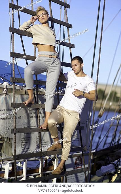 Australia, Adelaide, Fashion Bloggers Sarah Jeavons and Reno Marrasso on mast of ship, couple, travelling, wanderlust, travel lust, cool attitude, relationship