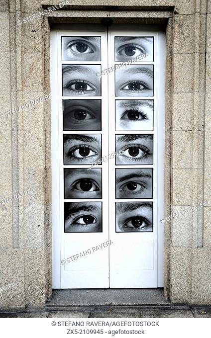 Door covered with eyes - Coruna, Galicia - Spain