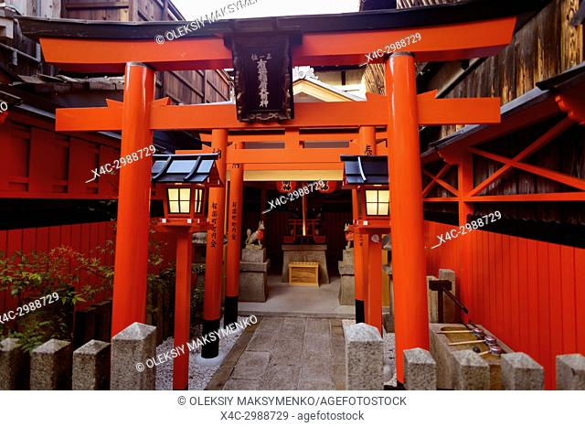 Orange Torii of a small Inari Shinto shrine on the street in Gion district, Kyoto, Japan