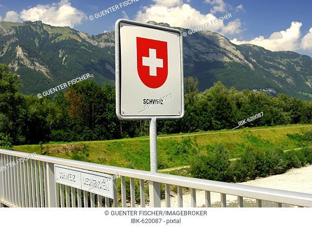 Swiss border sign on the Rhine river bridge, national border Switzerland, Principality of Liechtenstein