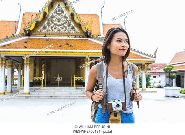 Thailand, Bangkok, portrait of tourist with camera