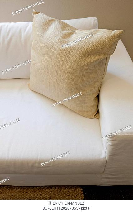 Close-up of a cushion on couch in the living room at home