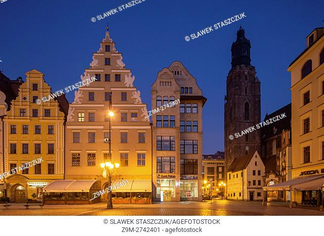 Before dawn at medieval market square in Wroclaw, Poland. St Elizabeth church tower in the distance