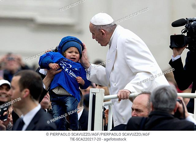 Pope Francis greets a baby during General audience, St. Peter Square, Vatican, Rome, ITALY-22-02-2017  Journalistic use only