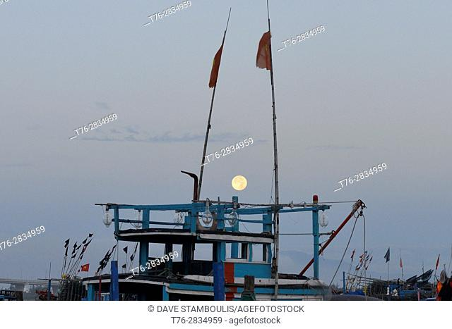 Full moonset at dawn, Hoi An, Vietnam