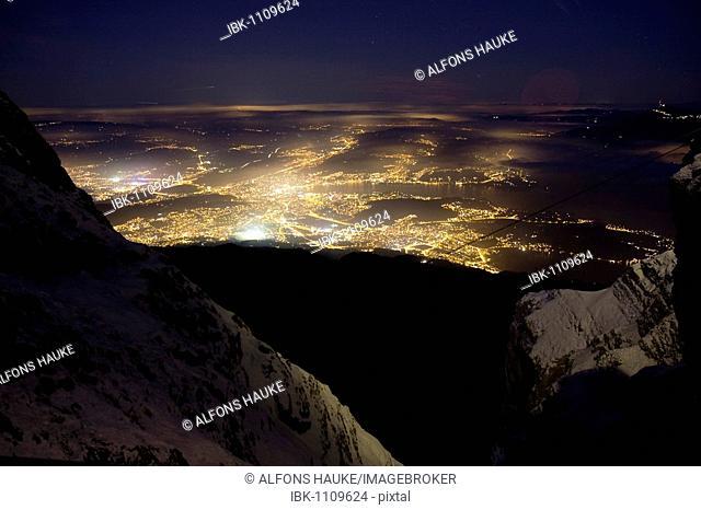 Lucerne at night in winter, Pilatus mountain range, Lucerne, Switzerland