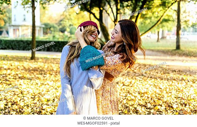 Spain, Gijon, Two best friends in a park in autumn