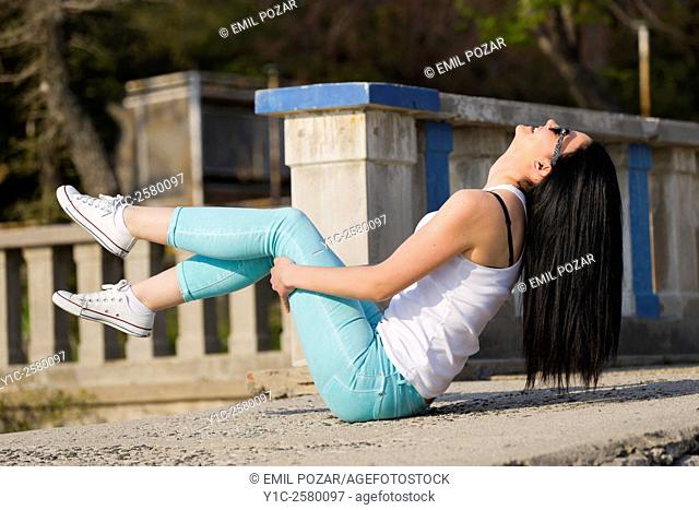 Happy and balancing on her bottom young woman